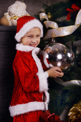 Boy Santa Claus with Christmas decorations