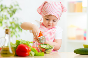 kid girl preparing vegetables