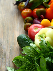 Fresh tomatoes and cucumbers, vegetables on boards