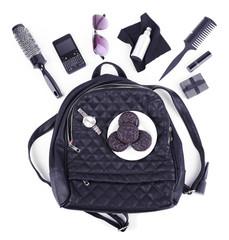 Content female handbag isolated on white