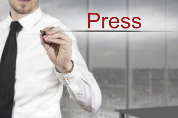 businessman writing press in the air