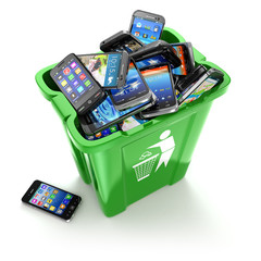 Mobile phones in trash can isolated on white background. Utiliza