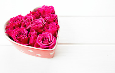 roses in a heart-shaped bowl