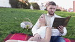 Couple on lawn reading book