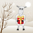 merry sheep with a gift on a background winter landscape