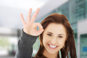 Happy woman with OK hand sign