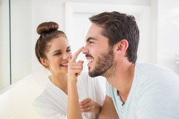 Young woman touching her boyfriends nose