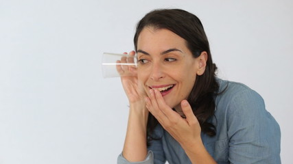 Sneaky woman listening to secrets using a glass