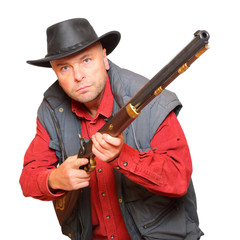 Cowboy with big bore rifle isolated on a white background.