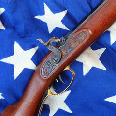The Hawken Rifle on american flag.