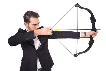 Elegant businessman shooting bow and arrow