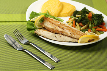 Tasty fish with lemon and vegetables