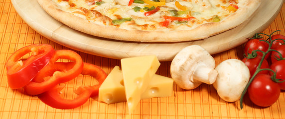 delicious pizza on wooden table vegetables cheese