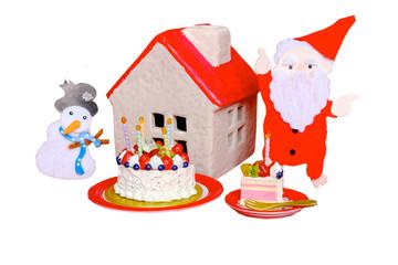 煙突を指さすサンタと赤い屋根の家と雪だるま
