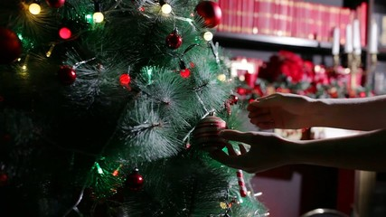 Hanging a Christmas ball,  Christmas tree