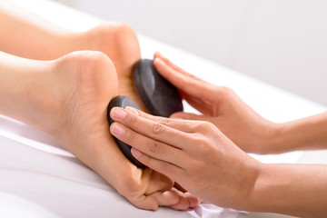 Hot stone feet massage