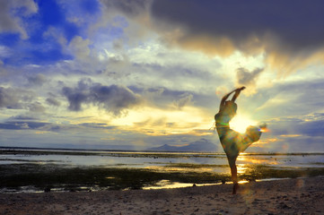 Woman dance at the Sunset over Bali as seen from Gili, Indonesia