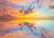 Beautiful sunset over sea with reflection in water - 73512083