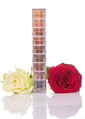 bright and colorful eye shadows stack  with rose