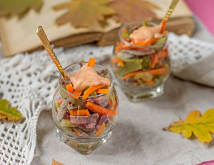 Salad with beef, carrots and pickles