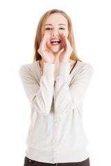 Portrait of happy whispering woman