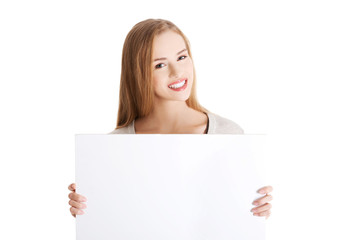 Portait of happy woman holding an empty baner