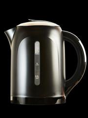 Modern teapot isolated on black