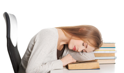 Tired woman slepping on books