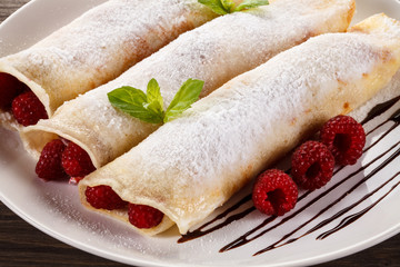 Pancakes with cream and raspberry