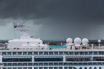 Cruise Ship with Storm Clouds in Background