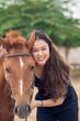 Girl with chestnut pony