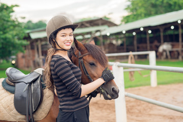 Jockey girl and her horse