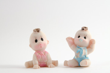 Baby girl and boy on the white background