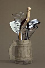 Kitchen utensils in a wooden mug