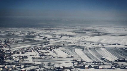 aerial view over small village in wintertime