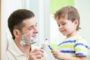 dad and son shaving in bathroom