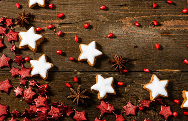 Texture on wooden background with Christmas cookies