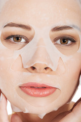Portrait of a woman with white facial mask