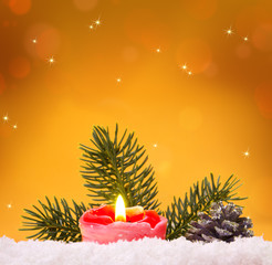 Advent candle isolated on yellow  background.