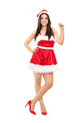 Girl in Santa costume leaning against a wall