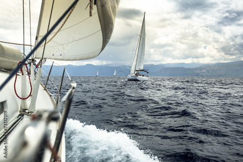 Sailing. Yacht race during stormy weather. - 73517019