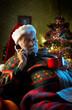 Santa Claus relaxing at home on the phone