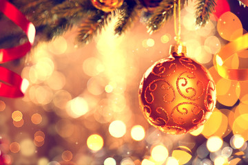Christmas decoration. Golden bauble hanging on Christmas tree