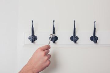 Hand hanging key on hook