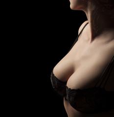female torso with bra on black background