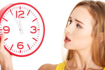 Portrait of a woman holding big clock