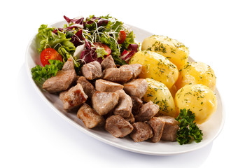 Grilled meat with boiled potatoes and vegetables