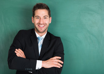 Happy Businessman Standing Over Green Background