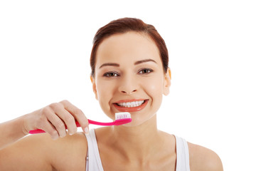 Woman with great teeth holding toothbrush
