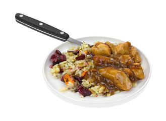 Chicken with rice TV dinner on plate